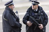 Armed police officers stand guard on Whitehall during Remembrance Sunday service in central London on November 9 2014 Services are held annually...