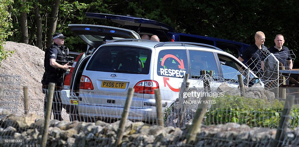 Armed Police officers stand in a wooded area, close to where the car belonging to Derrick Bird was found, and to where he is believed to have killed himself, in Boot, near Whitehaven, Cumbria, north west England on June 2, 2010. At least five people were killed when a gunman went on the rampage through one of Britain's most popular tourist regions Wednesday before apparently killing himself. Derrick Bird, a 52-year-old taxi driver, spent nearly four hours driving through the Lake District in northwest England, reportedly shooting at people in 11 different locations from his car window.