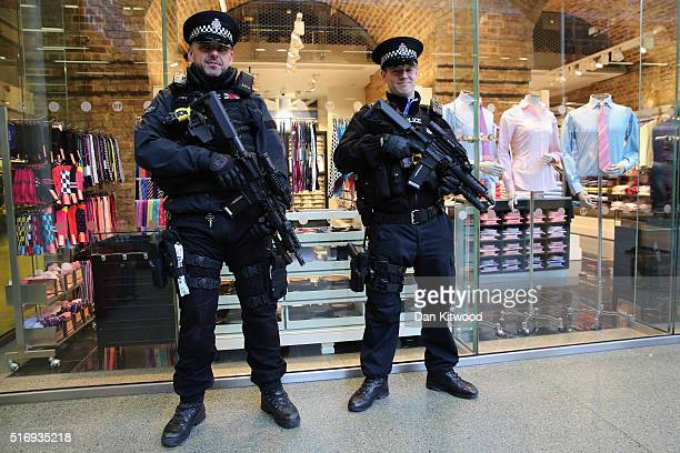 Armed Police Officers stand near the entrance to the Eurostar at St Pancras Station on March 22 2016 in London England Journeys to Brussels were...