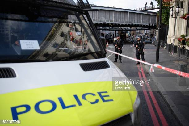 Armed police officers stand near the location where the attacker's van crashed on London Bridge after it was reopened following the June 3rd terror...