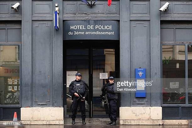 Armed Police Officers stand outside a Police Station near the on January 8 2015 in Paris France Twelve people were killed yesterday including two...