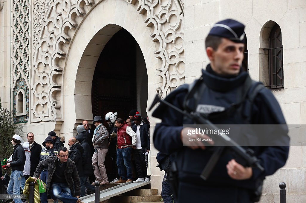 Armed police officers stand outside the Grand Mosque on January 9 2015 in Paris France Both sieges in France are now believed to be over following...