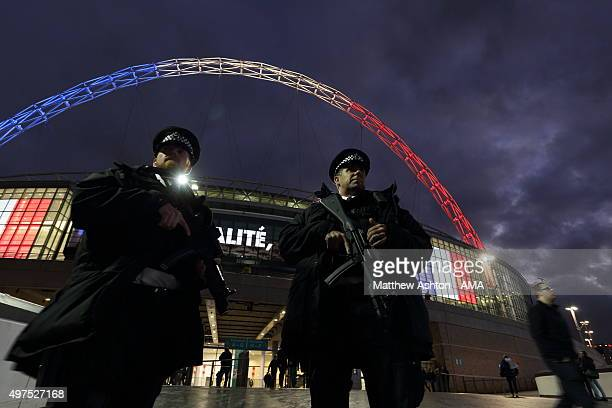 Armed Police Officers stand outside Wembley Stadium ahead of tonight's International friendly match between England and France at Wembley Stadium on...