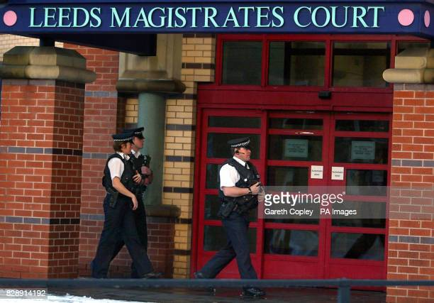 Armed police officers walk past the entrance to Leeds Magistrates Court where David Francis Bieber also known as Nathan Wayne Coleman appeared...