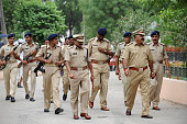 Armed police officials patrol the court premises at Mehsana some 70 kms from Ahmedabad on July 30 2012 The court convicted 22 accused in the 2002...