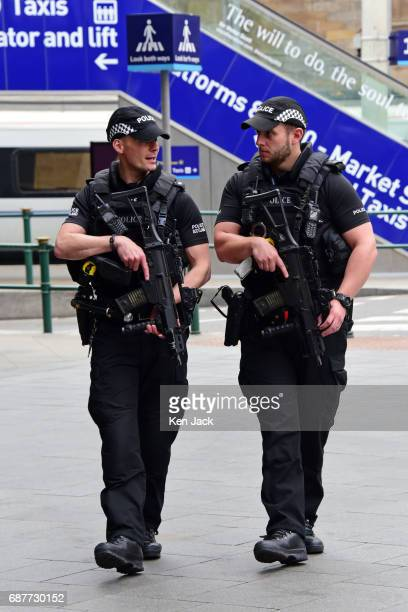 Armed police on patrol in Waverley Station on May 24 2017 in Edinburgh United Kingdom Heightened security has been put in place throughout the UK...