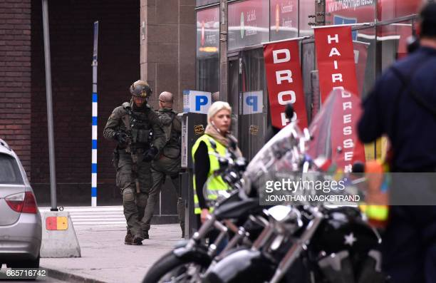 Armed police operates at the scene where a truck crashed into the Ahlens department store at Drottninggatan in central Stockholm April 7 2017 PHOTO /...
