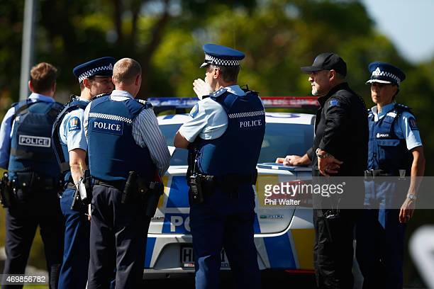 Armed police patrol a roadblock on April 16 2015 in Auckland New Zealand Police were called to Blockhouse Bay after an armed incident was reported...