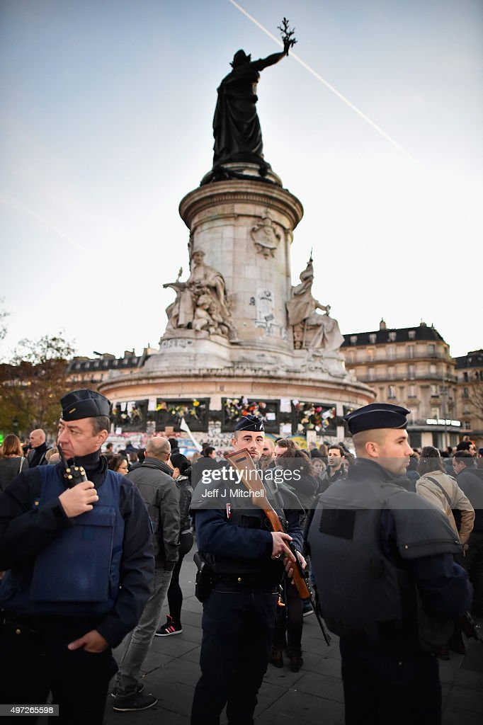 Armed police patrol at Place de la Republique as France observes three days of national mourning for the victims of the terror attacks on November 15, 2015 in Paris, France. As France observes three days of national mourning members of the public continue to pay tribute to the victims of Friday's deadly attacks. A special service for the families of the victims and survivors is to be held at Paris's Notre Dame Cathedral.