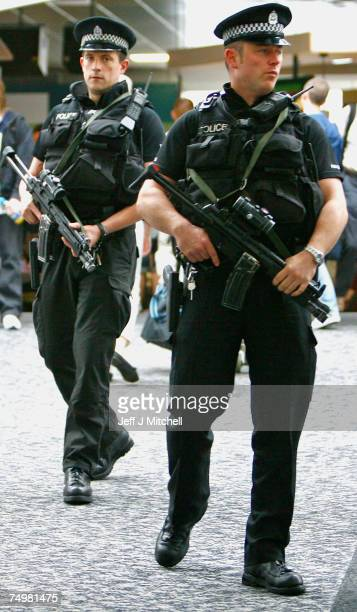 Armed police patrol Glasgow Airport as the UK terror alert remains at a critical level June 2 2007 in Glasgow Scotland Police have arrested a further...
