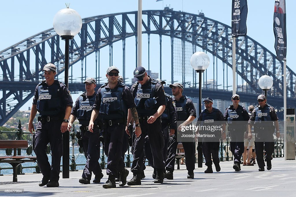 Armed police patrol on December 15 2014 in Sydney Australia Major landmarks in Sydney including the Sydeny Opera House have been evacuated as police...