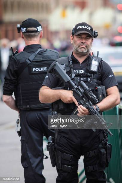 Armed police patrol outside on day 3 of Royal Ascot at Ascot Racecourse on June 22 2017 in Ascot England The fiveday Royal Ascot meeting is one of...