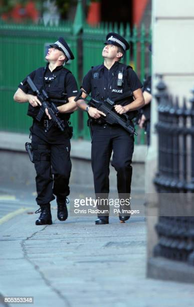 Armed Police patrol outside the Royal Court Building in St Hellier Jersey before the arrival of Curtis Warren from Liverpool who is accused alongside...