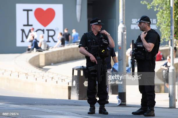 Armed police patrol the city centre ahead of a national minute's silence in remembrance of all those who lost their lives in the Manchester Arena...