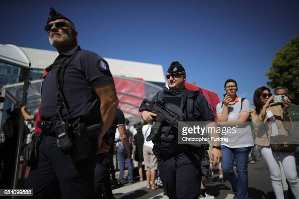 Armed police patrol The Croisette on the first day of the 70th annual Cannes Film Festival at the Palais des Festivals on May 17 2017 in Cannes...