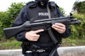 Armed police patrol the roads leading to the Lough Erne Golf Resort in Enniskillen Northern Ireland on June 15 in preparation for the G8 Summit...