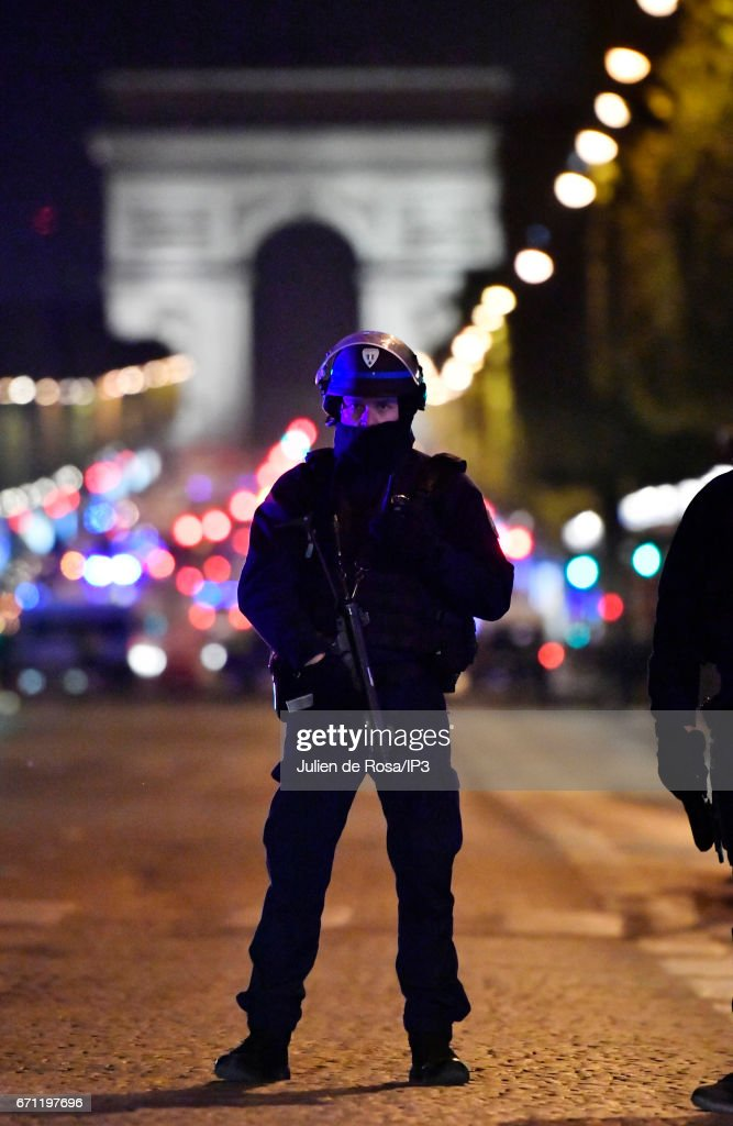 Armed police secure the area after a shooting occurred on the Champs-Elysees avenue on April 20, 2017 in Paris, France. One police officer was killed and another wounded in a shooting on Paris's Champs Elysees, police said just days ahead of France's presidential election. France's interior ministry said the attacker was killed in the incident on the world famous boulevard that is popular with tourists.