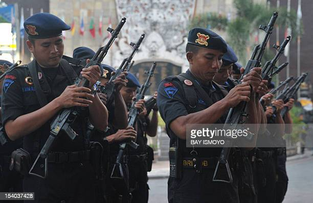 Armed police secure the site of the 2002 Bali bombings memorial monument in the Kuta tourist area near Denpasar on the Indonesian resort island of...