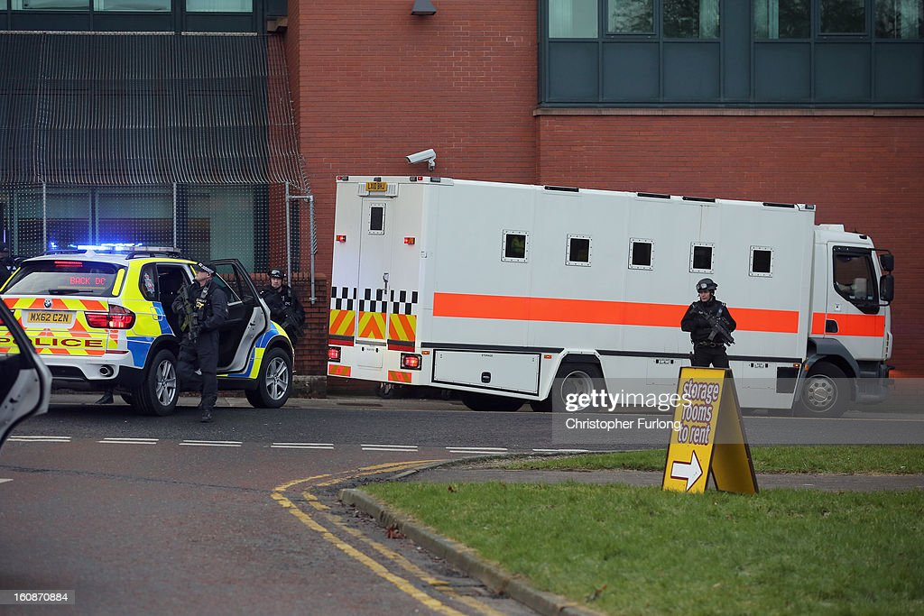 Armed police stand guard as Dale Cregan and nine other co-defendants arrive in an armed convoy to face charges of murder and attempted murder at Preston Crown on February 7, 2013 in Preston, Lancashire. Dale Cregan, 29, stands accused of four murders, including PC Nicola Hughes and PC Fiona Bone on September 18, 2012 and also in two separate attacks earlier this year of Mark Short and his father David Short. Cregan is also being charged with an additional four counts of attempted murder.