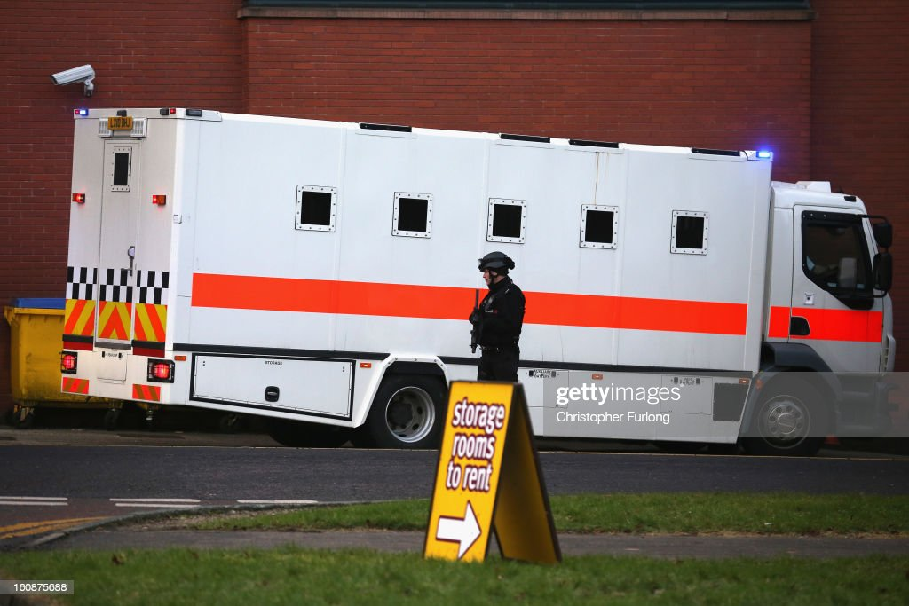 Armed police stand guard as Dale Cregan and nine other co-defendants arrive in an armed convoy to face charges of murder and attempted murder at Preston Crown Court on February 7, 2013 in Preston, Lancashire. Dale Cregan, 29, stands accused of four murders, including PC Nicola Hughes and PC Fiona Bone on September 18, 2012 and also in two separate attacks earlier this year of Mark Short and his father David Short. Cregan is also being charged with an additional four counts of attempted murder.