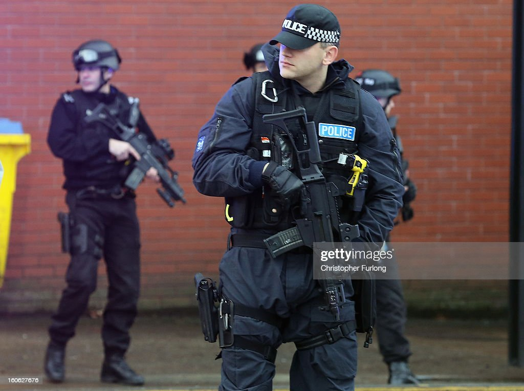 Armed police stand guard as Dale Cregan arrives in an armed convoy to face charges of murder and attempted murder at Preston Crown Court on February 4, 2013 in Preston, England. Dale Cregan, 29, stands accused of four murders, including PC Nicola Hughes and PC Fiona Bone on September 18, 2012 and also in two separate attacks earlier this year of Mark Short and his father David Short. Cregan is also being charged with an additional four counts of attempted murder.