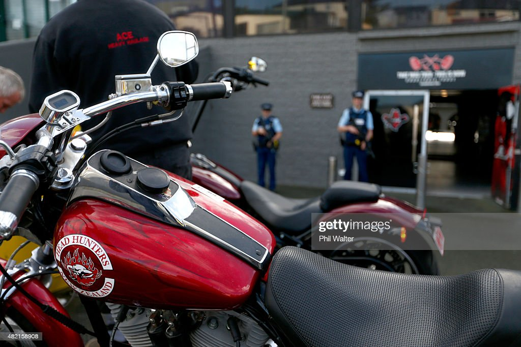 Armed police stand guard as seized motorcycles are removed from a boxing gym run by the Head Hunters gang on Marua Road in Ellerslie on July 28 2015...