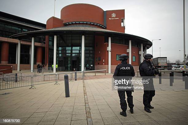 Armed police stand guard as the trial of Dale Cregan and nine other codefendants face charges of murder and attempted murder at Preston Crown Court...