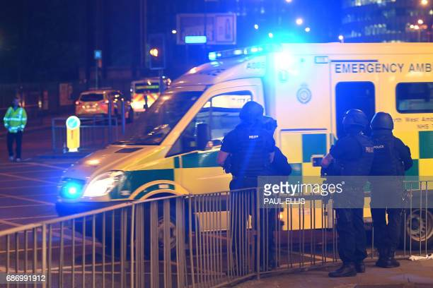 Armed police stand guard at the scene of a suspected terrorist attack during a pop concert by US star Ariana Grande in Manchester northwest England...
