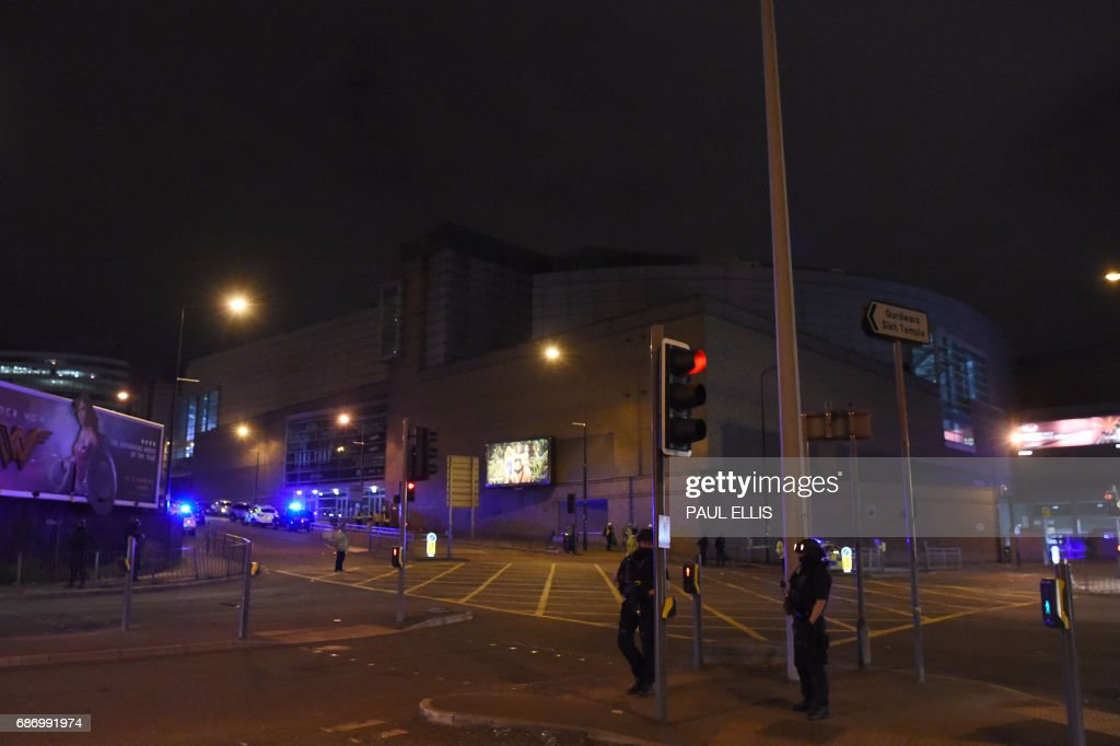 Armed police stand guard at the scene of a suspected terrorist attack during a pop concert by US star Ariana Grande in Manchester, northwest England on May 23, 2017.