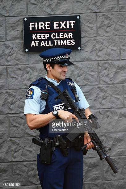 Armed police stand guard outside a boxing gym run by the Head Hunters gang on Marua Road in Ellerslie on July 28 2015 in Auckland New Zealand Police...