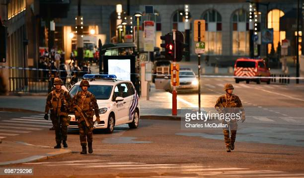 Armed police stand guard outside Brussels Central train station after a man triggered a small explosion inside the station on June 20 2017 in...