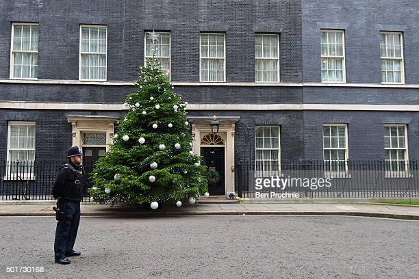 Armed police stand guard outside Number 10 Downing Street on December 17 2015 in London England Security across London has tightened in the run up to...