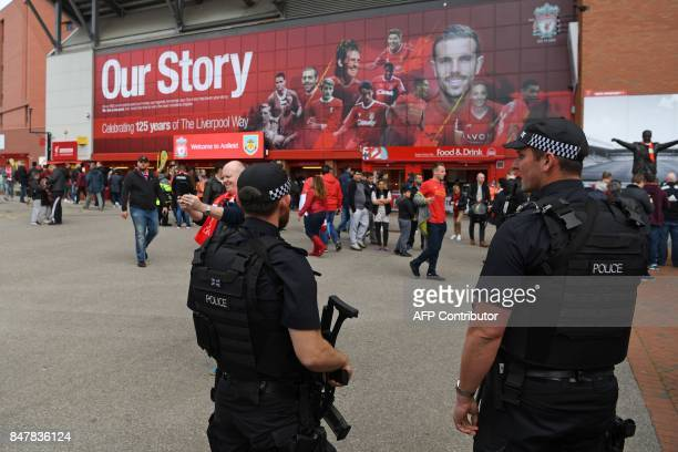 Armed police stand guard outside the stadium before the English Premier League football match between Liverpool and Burnley at Anfield in Liverpool...