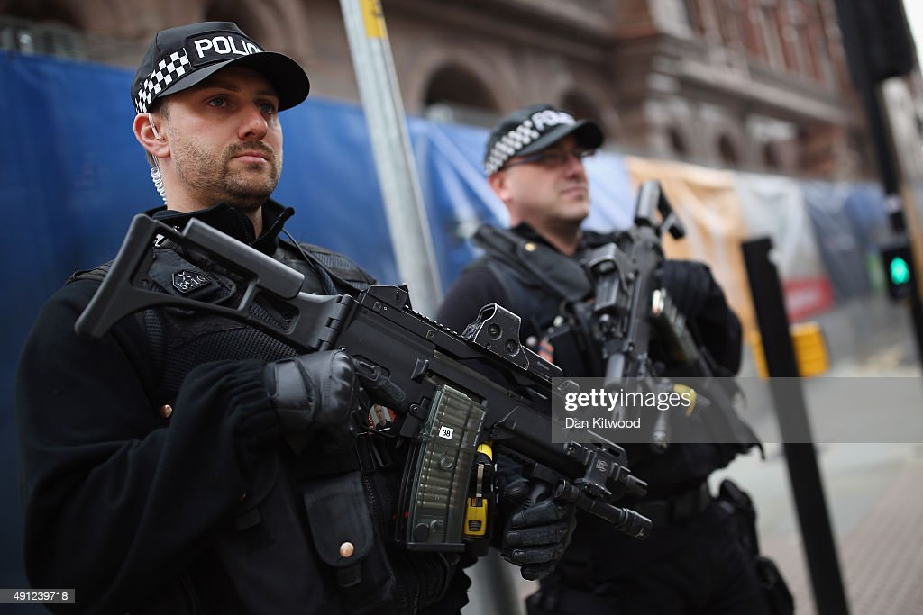 Armed police stand outside Manchester Central on day one of the Conservative Party Conference on October 4 2015 in Manchester England Up to 80000...