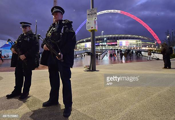 Armed police stand outside Wembley Stadium in west London on November 17 ahead of the international friendly football match between England and...