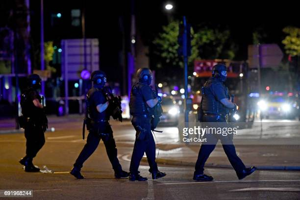 Armed police walk down Borough High Street towards Vauxhall on June 3 2017 in London England Police have responded to reports of a van hitting...