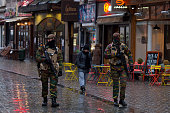 Armed policemen patrol along Rue Du Marche Aux Poulets on November 24 2015 in Brussels Belgium At a press conference last night the Belgian Prime...