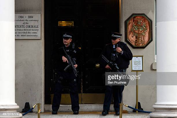 Armed policemen stand guard outside the French Embassy on November 16 2015 in London England Security in London has tightened after a series of...