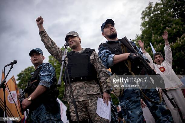 Armed proRussian activists guard selfproclaimed 'governer' of Luhansk Valery Bolotov during celebrations of what they claimed was resounding victory...