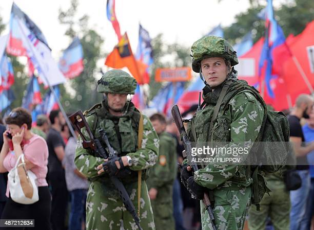 Armed proRussian rebels of the selfproclaimed Donetsk People's Republic take part in a rally at Saur Mogyla Memorial on September 7 to mark the...