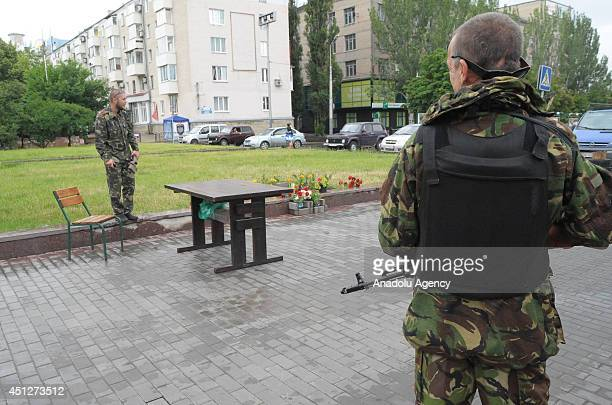 Armed proRussian separatists keep guard Representatives of Selfproclaimed Donetsk People's Republic and Selfproclaimed Lugansk People's Republic hold...