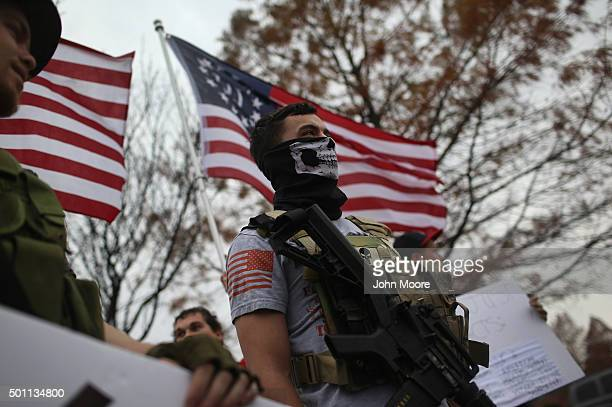 Armed protesters from the Bureau of AmericanIslamic Relations stage a demonstration in front of the Islamic Association of North Texas at the Dallas...
