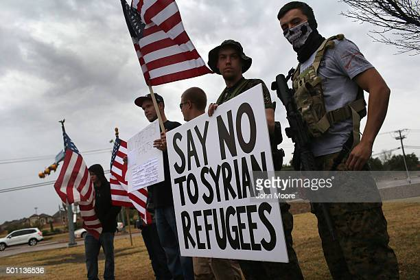 Armed protesters from the socalled Bureau of AmericanIslamic Relations take part in a demonstration in front of a mosque on December 12 2015 in...