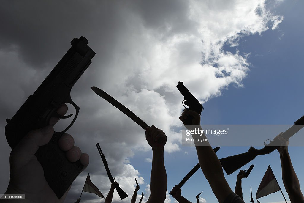 Armed Rebellion with Approaching Storm : Stock Photo