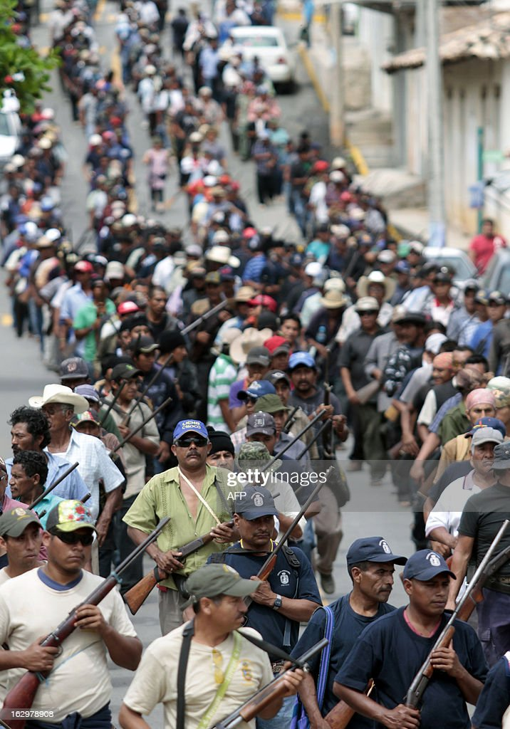 Armed residents take part in the March for Justice and Dignity, in Ayutla de los Libres, on March 2, 2013, in the southwestern State of Guerrero, Mexico. Hundreds of civilians armed with rifles, pistols and machetes decided to provide security for the communities of Guerrero, creating a vigilante force, saying gangs were committing robberies, kidnappings and murder. Guerrero, home to the Pacific resort town of Acapulco, has been one of the states hardest hit by Mexico's drug violence, which has left more than 70,000 people killed across the country since 2006. AFP PHOTO/Pedro Pardo
