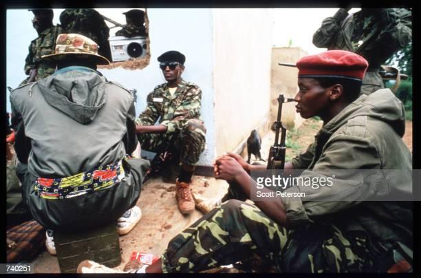 Armed Rwanda Patriotic Front soldiers sit May 26 1994 in Kigali Rwanda A civil war erupts leading to the Rwandan slaughter of an estimated 800000...