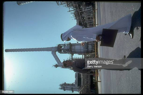 Armed security guard w briefcasecarrying Saudi at Saudi Aramco oil refinery loading terminal at Ras Tanura Saudi Arabia
