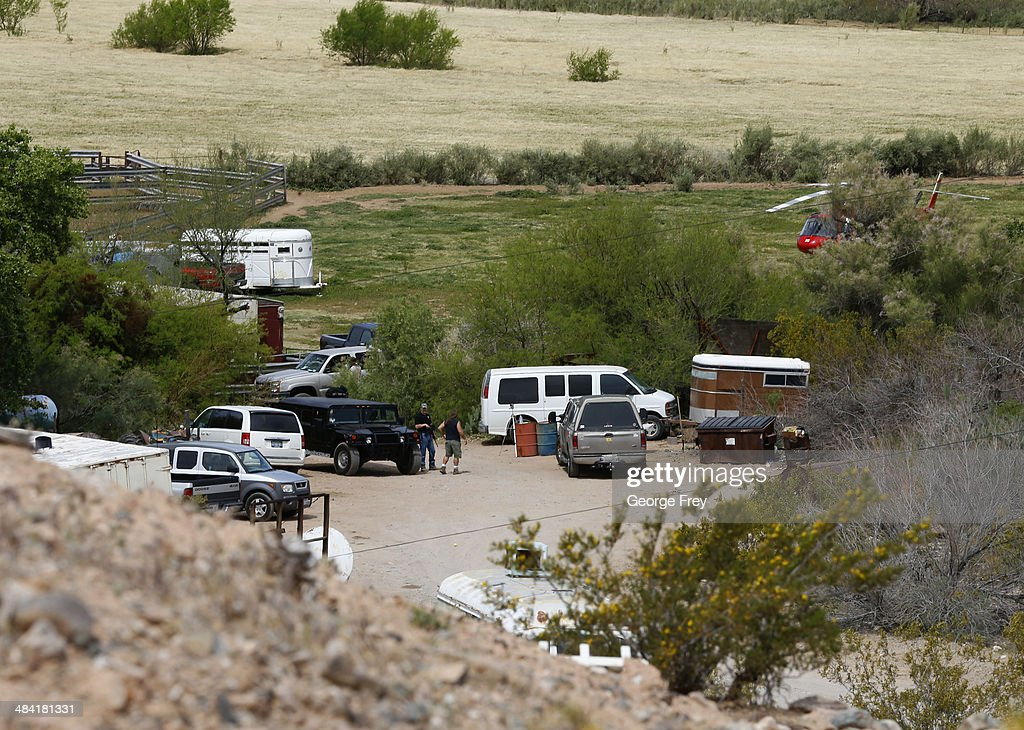 Armed security guards guard the entrance to Rancher Cliven Bundy ranch house on April 11, 2014 west of Mesquite, Nevada. Bureau of Land Management officials are rounding up Cliven Bundy's cattle, he has been locked in a dispute with the BLM for a couple of decades over grazing rights.