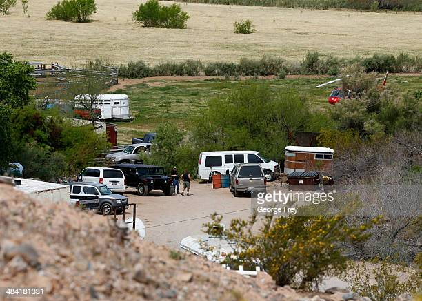 Armed security guards guard the entrance to Rancher Cliven Bundy ranch house on April 11 2014 west of Mesquite Nevada Bureau of Land Management...