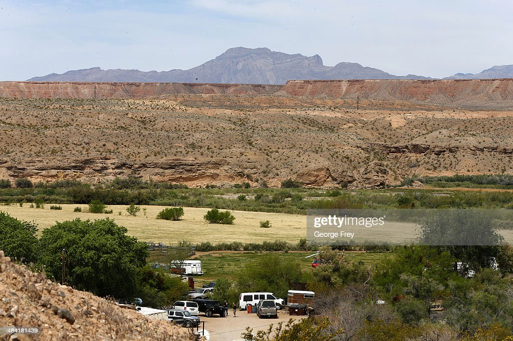 Armed security guards guard the entrance to Rancher <a gi-track='captionPersonalityLinkClicked' href=/galleries/search?phrase=Cliven+Bundy&family=editorial&specificpeople=12726092 ng-click='$event.stopPropagation()'>Cliven Bundy</a> ranch house on April 11, 2014 west of Mesquite, Nevada. Bureau of Land Management officials are rounding up <a gi-track='captionPersonalityLinkClicked' href=/galleries/search?phrase=Cliven+Bundy&family=editorial&specificpeople=12726092 ng-click='$event.stopPropagation()'>Cliven Bundy</a>'s cattle, he has been locked in a dispute with the BLM for a couple of decades over grazing rights.
